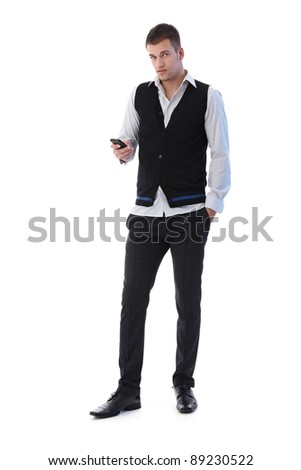 Handsome young man using mobile phone, writing text message.?