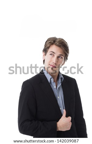 Handsome young man with a quizzical expression standing looking up into the air isolated on white