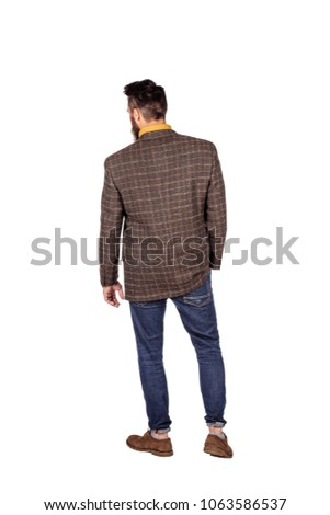 Handsome young man with beard full height standing against white background. human emotion expression and lifestyle concept. #1063586537