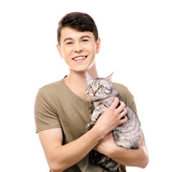 Handsome young man with cute cat isolated on white