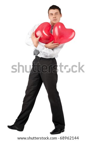 Handsome young man with two red heart-like balloons for Valentine's Day, isolated on white