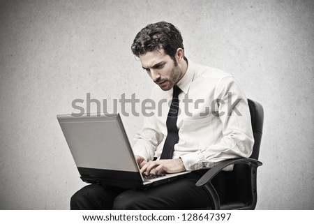 handsome young man working with laptop