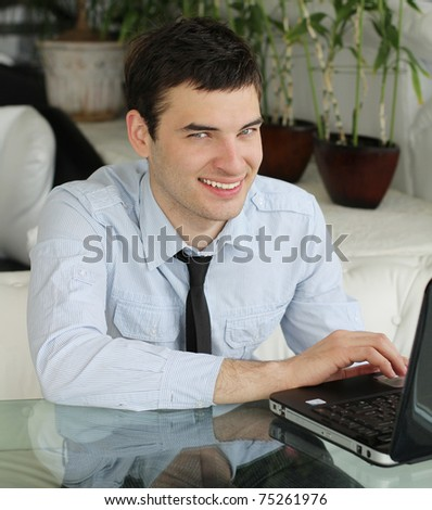 Handsome young men with laptop in public space. businessman.  smile a happy  smile