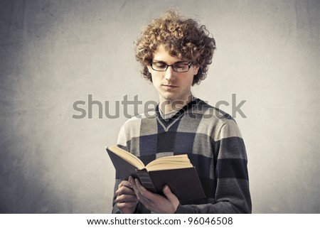 Handsome young student reading a book