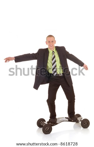 Handsome young successful businessman high speed surfing towards success, metaphor with skateboard, studio shot.