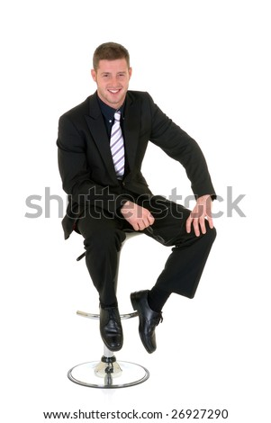 Handsome young successful businessman, sitting on bar stool, white background,  studio shot.
