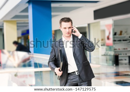 Handsome young successful businessman talking on his mobile