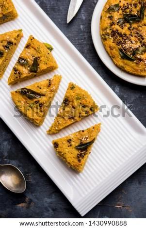 Handvo / handwa is a vegetable cake originating from the Gujarat, India. selective focus #1430990888