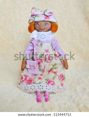 handwork - a doll in a pink dress and a hat with a bag