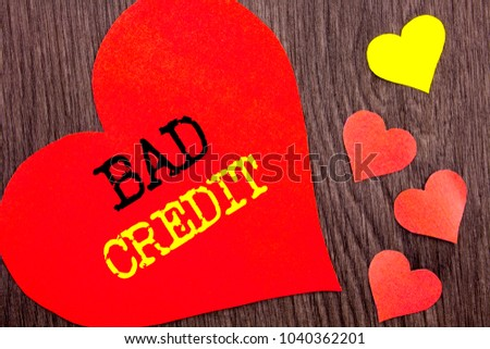 Handwriting Announcement text showing Bad Credit. Concept meaning Poor Bank Rating Score For Loan Finance written Heart Love the wooden background.