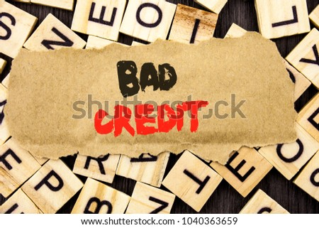 Handwriting Announcement text showing Bad Credit. Concept meaning Poor Bank Rating Score For Loan Finance written tear paper note the letter and wood background.