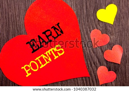 Handwriting Announcement text showing Earn Points. Concept meaning Loyalty Reward Benefit Program For Earning Customer Point written Heart Love the wooden background. #1040387032