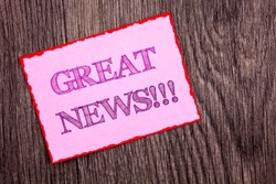 Handwriting Announcement text showing Great News. Conceptual photo Success Newspaper Information Celebration written Pink Sticky Note Paper the wooden background.