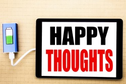 Handwriting Announcement text showing Happy Thoughts. Business concept for Happiness Thinking Good Written on tablet with white background charger power bank.
