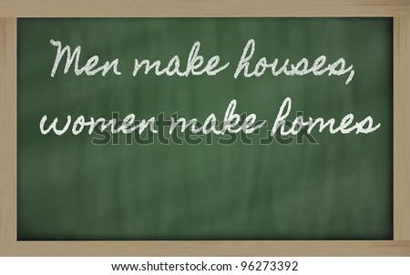 handwriting blackboard writings - Men make houses, women make homes - stock photo