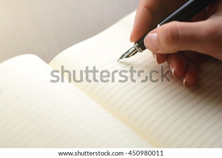 handwriting, hand writes a pen in a notebook #450980011