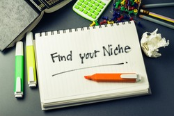 Handwriting of Find Your Niche word in notebook on the desk