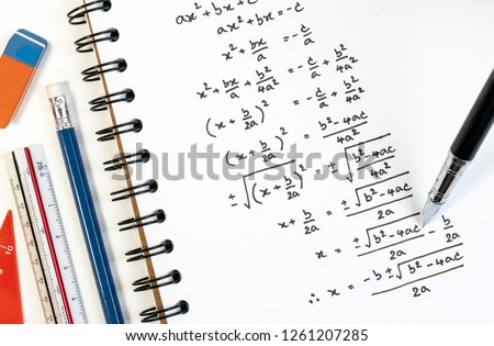 Handwriting of mathematics quadratic equation formula on examination, practice, quiz or test in maths class. Solving exponential equations background concept. Stockfoto ©