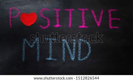 handwriting positive mind  on chalkboard