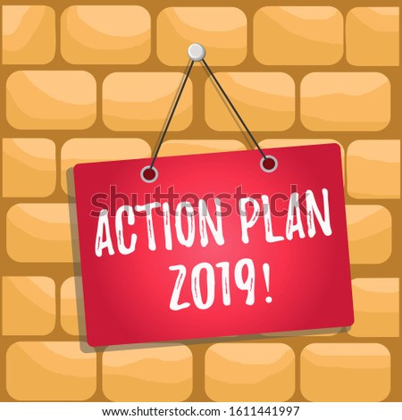 Handwriting text Action Plan 2019. Concept meaning proposed strategy or course of actions for current year Colored memo reminder empty board blank space attach background rectangle.