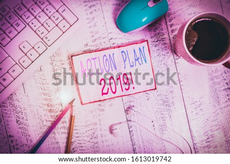 Handwriting text Action Plan 2019. Concept meaning proposed strategy or course of actions for current year technological devices colored reminder paper office supplies keyboard mouse.