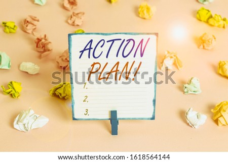 Handwriting text Action Plan. Concept meaning proposed strategy or course of actions for certain time Colored crumpled papers empty reminder pink floor background clothespin.