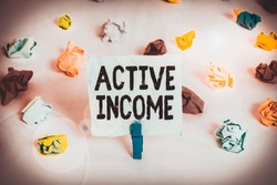 Handwriting text Active Income. Concept meaning Royalties Salaries Pensions Financial Investments Tips Colored crumpled papers empty reminder white floor background clothespin.