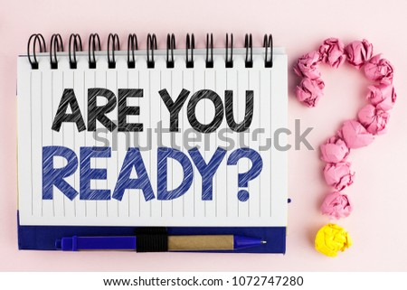 Handwriting text Are You Ready Question. Concept meaning asking about availability Lets go out Study Work written Notebook Book the plain background Pen next to it Ask for.