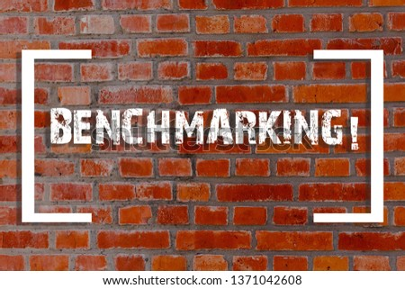 Handwriting text Benchmarking. Concept meaning evaluate something by comparison with standard or scores Brick Wall art like Graffiti motivational call written on the wall. #1371042608