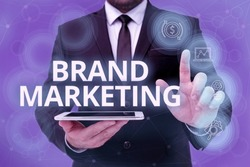 Handwriting text Brand Marketing. Business approach creating a name that identifies and differentiates a product Man In Office Uniform Standing Pressing Virtual Button Holding Tablet.