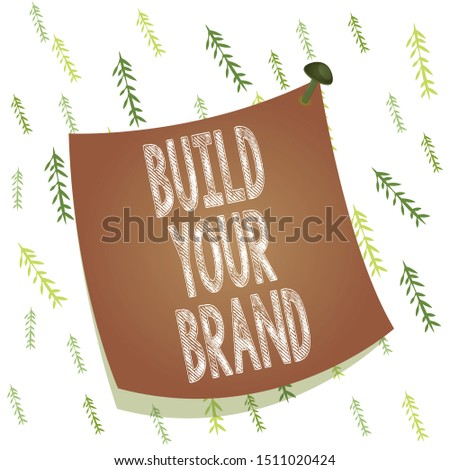 Handwriting text Build Your Brand. Concept meaning enhancing brand equity using advertising campaigns Curved reminder paper memo nailed colorful surface stuck blank pin frame.
