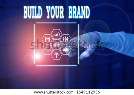 Handwriting text Build Your Brand. Concept meaning enhancing brand equity using advertising campaigns Picture photo system network scheme modern technology smart device.