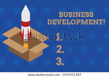 Handwriting text Business Development. Concept meaning Implement Growth Value within and between company Fire launching rocket carton box. Starting up project. Fuel inspiration.