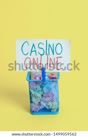 Handwriting text Casino Online. Concept meaning Computer Poker Game Gamble Royal Bet Lotto High Stakes Trash bin crumpled paper clothespin empty reminder office supplies yellow. #1499059562