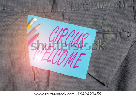Handwriting text Circus Welcome. Concept meaning the exhibitions of pageantry Feats of skill and daring Writing equipment and blue note paper inside pocket of man work trousers.