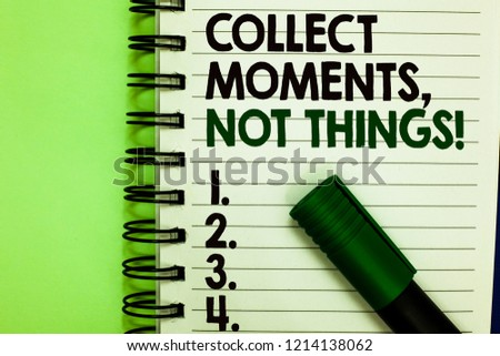Handwriting text Collect Moments, Not Things. Concept meaning Happiness philosophy enjoy simple life facts Written letters and numbers on notepad laid green marker green back. #1214138062
