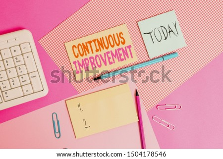 Handwriting text Continuous Improvement. Concept meaning ongoing effort to improve products or processes Writing equipments and computer stuffs placed above colored plain table.