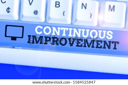 Handwriting text Continuous Improvement. Concept meaning ongoing effort to improve products or processes.