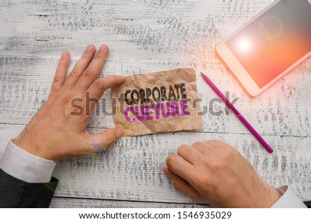 Handwriting text Corporate Culture. Concept meaning pervasive values and attitudes that characterize a company Hand hold note paper near writing equipment and modern smartphone device.