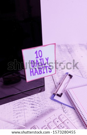 Handwriting text 10 Daily Habits. Concept meaning Healthy routine lifestyle Good nutrition Exercises Note paper taped to black computer screen near keyboard and stationary.