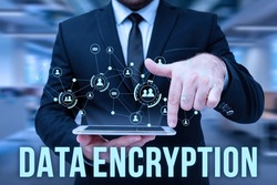 Handwriting text Data Encryption. Business showcase Symmetrickey algorithm for the encrypting electronic data Man In Uniform Standing Holding Tablet Typing Futuristic Technologies.