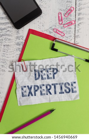 Handwriting text Deep Expertise. Concept meaning Great skill or broad knowledge in a particular field or hobby Clipboard paper sheet pencil smartphone note clips wooden retro background. #1456940669