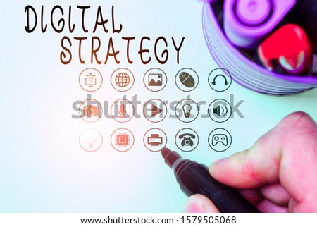 Handwriting text Digital Strategy. Concept meaning plan for maximizing the business benefits of data assets.