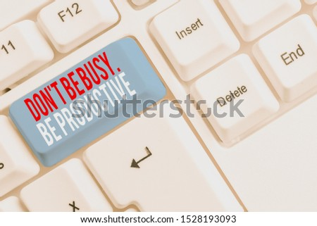 Handwriting text Don T Be Busy Be Productive. Concept meaning Work efficiently Organize your schedule time White pc keyboard with empty note paper above white background key copy space. #1528193093