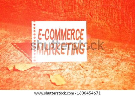 Handwriting text E Commerce Marketing. Concept meaning business that sells product or service electronically Empty Spiral Bound Notebook Sheet Torn Off Folded in Half Dried Leaves.