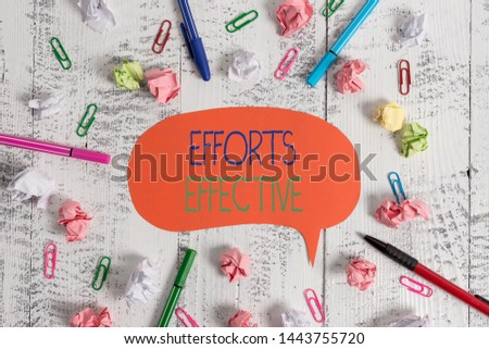 Handwriting text Efforts Effective. Concept meaning Produces the results as per desired Goal Target Achieve Blank speech bubble pens clips crushed paper balls vintage retro table.