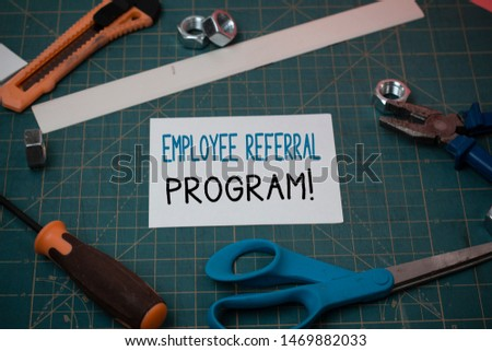 Handwriting text Employee Referral Program. Concept meaning internal recruitment method employed by organizations Carpentry equipments and plain paper scattered everywhere on measuring mat. #1469882033