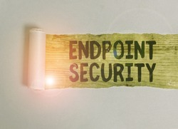 Handwriting text Endpoint Security. Concept meaning the methodology of protecting the corporate network Cardboard which is torn in the middle placed above a wooden classic table.