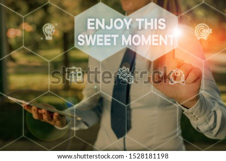 Handwriting text Enjoy This Sweet Moment. Concept meaning encouraging someone to love his life timeline Woman wear formal work suit presenting presentation using smart device.
