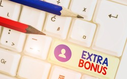 Handwriting text Extra Bonus. Concept meaning an extra amount of money that is added to someone s is pay.